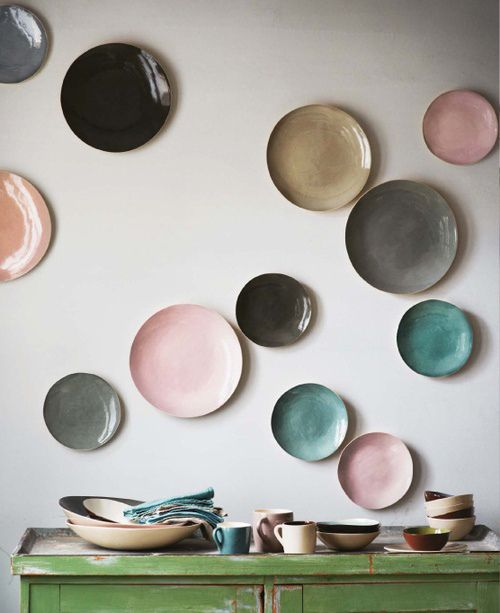 Pastel glazed plates on wall