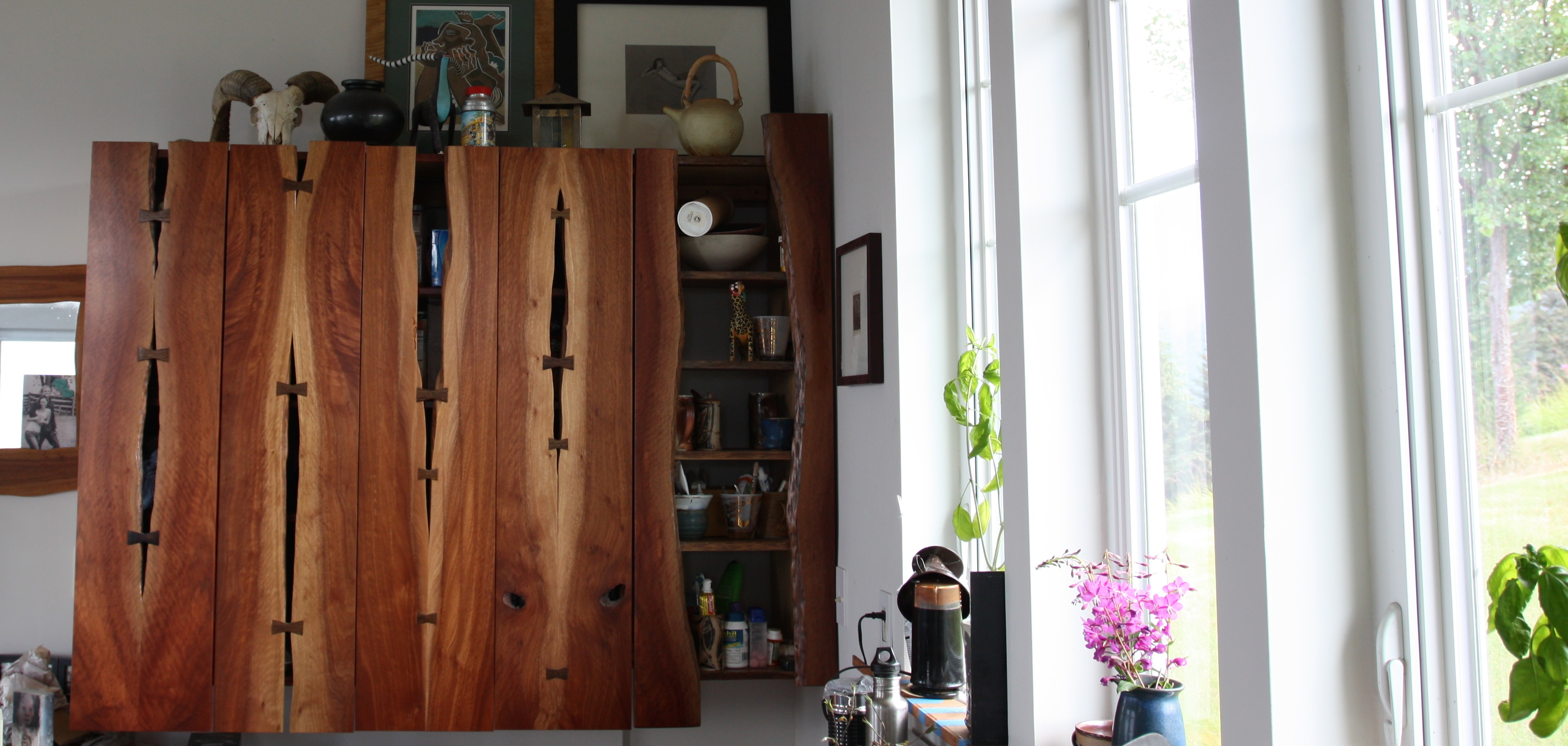 Steve made these cabinets out of salvaged wood.  I've never seen anything like them, and my photo does not do them justice.