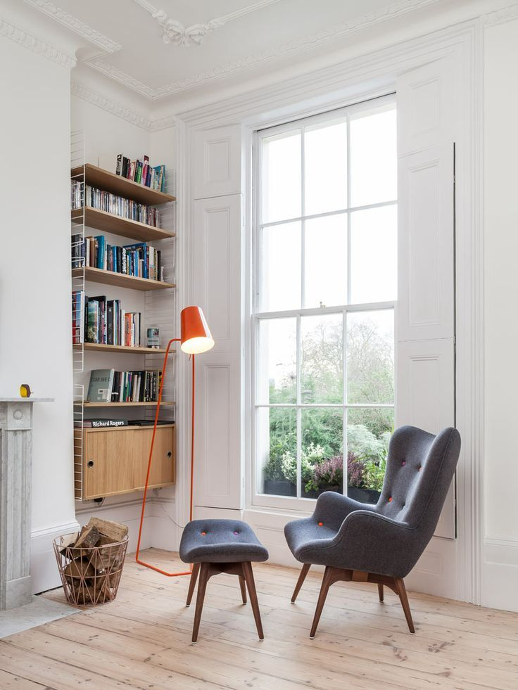 gray chair and orange lamp