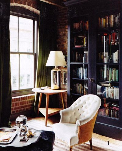 white chair in front of black bookcase