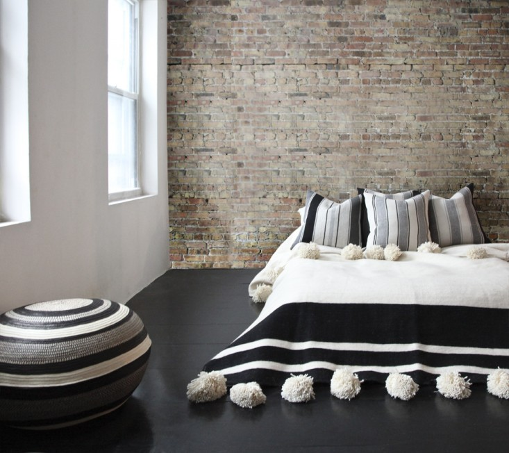 http://www.remodelista.com/posts/laviva-home-woven-poufs-alpaca-pillows-and-moroccan-pom-pom-blankets