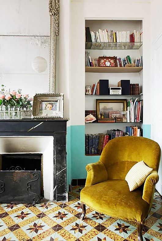 mustard chair with half turquoise wall