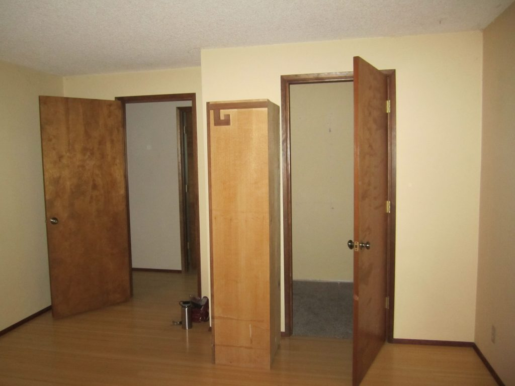 Looking out of the master bedroom, closet on the right and hallway on the left.